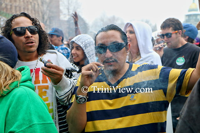 Patrons of the 4/20 Rally enjoy a smoke