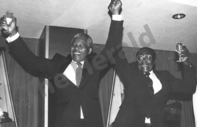 President Mugabe gives a toast to a closer relationship between Zimbabweans and progressive South Africans and to peace and prosperity in 1990.