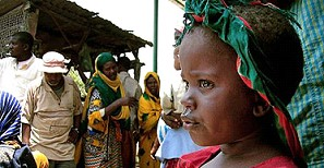 A girl watches as her family prepares to leave Mogadishu
